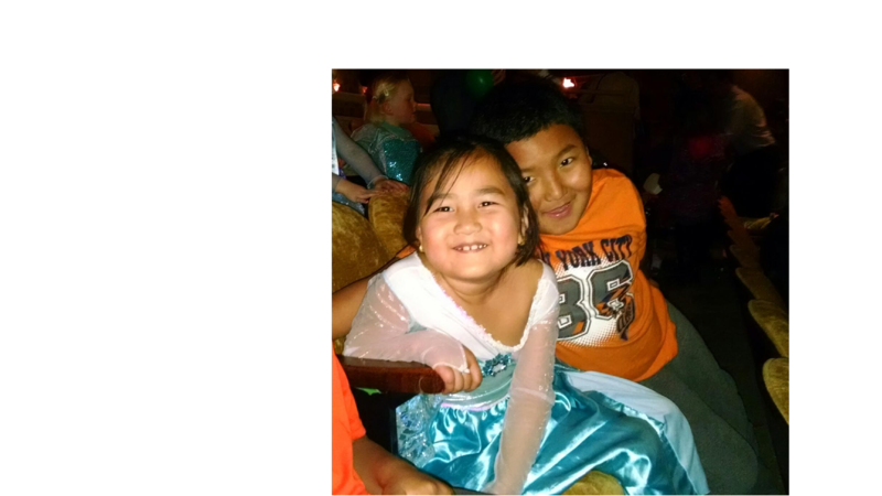 "Malin and her cousin, Bebak, attend a sing-a-long of the movie, Frozen. Malin wore her ice-blue ""Elsa"" dress."