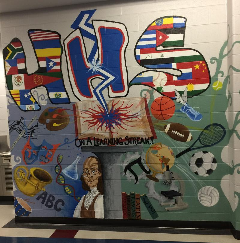 A mural reflects the multi cultural spirit of Harrisonburg High.