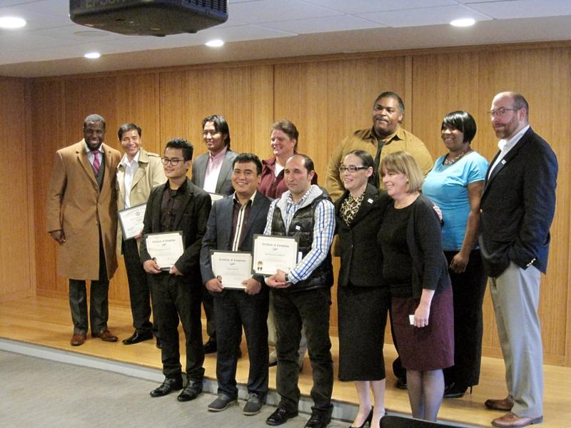 The group of seven GO Driver graduates poses with city employees and area partners who helped facilitate the program.