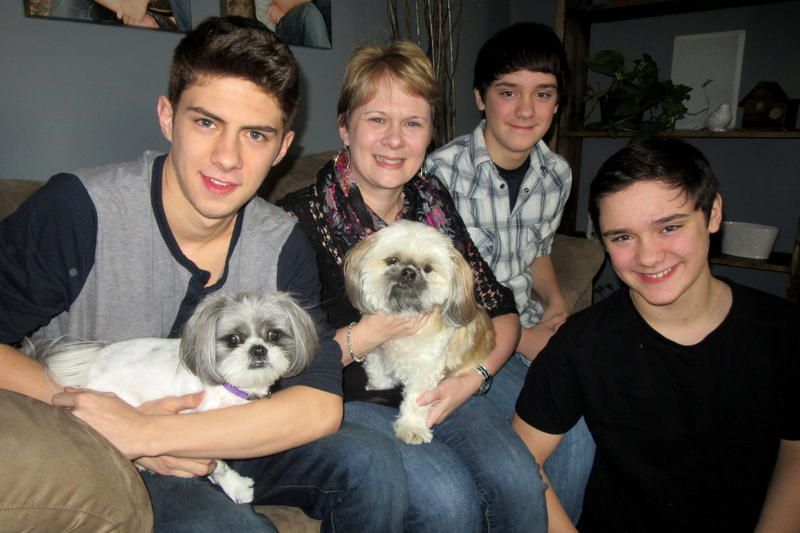 Heather Baker in her McGaheysville home with her sons Brandt, Carson, and Jordan, and dogs Charlie and Bailey