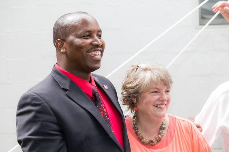 Pastor Peter Chege and Faith Painter together helped raise $120,000 to buy the Barboursville church where dozens of Congolese refugees worship in both English and Swahili.