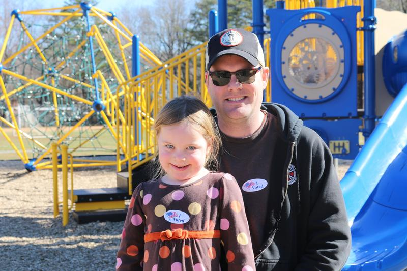Josh Metz poses with his daughter Katie after voting this morning at Woodbrook Elementary School. A registered Republican, Metz opted to vote for Bernie Sanders.