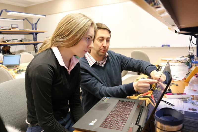 With only six students in Mechatronics class, engineering major Maddie Lee receives plenty of one-on-one attention from teacher (and Engineering Department Chair) Hank Yochum.
