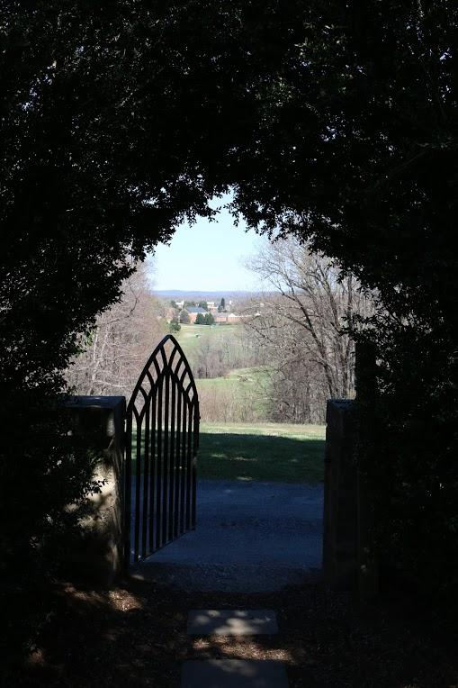 Many of Sweet Briar's buildings are visible through the gate of Monument Hill, situated at the high point of the campus.