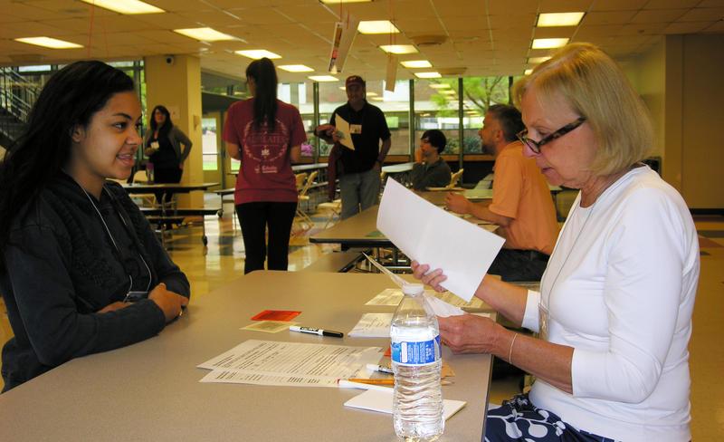 Piedmont CASA volunteer Susan Quisenberry works as a social services caseworker with a simulation participant.