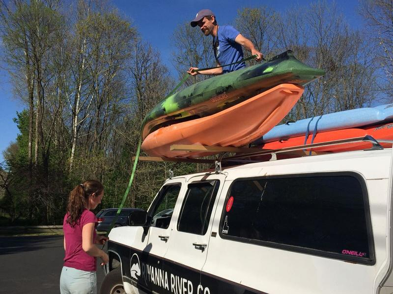 Team effort. The Charlottesville couple load up their kayaks and canoes.