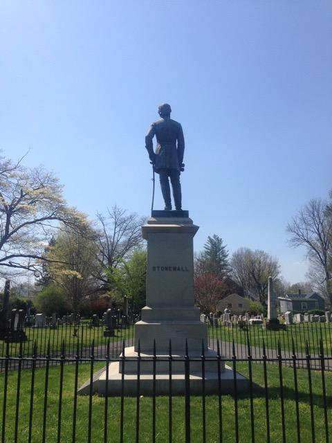 The statue of Confederate General Stonewall Jackson commands the cemetery.