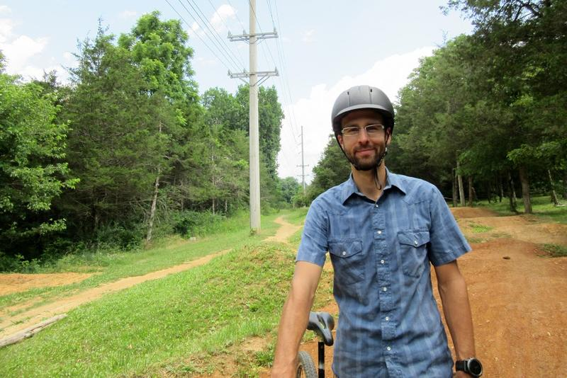 Shenandoah Valley Bicycle Coalition Board President Kyle Lawrence on the bike path at Hillandale Park.