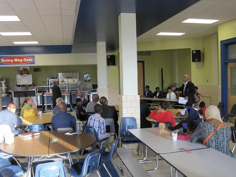 Younger members of the 100 Black Men of Central Virginia and their parents listen and ask questions of five student leaders at Burley Middle School.