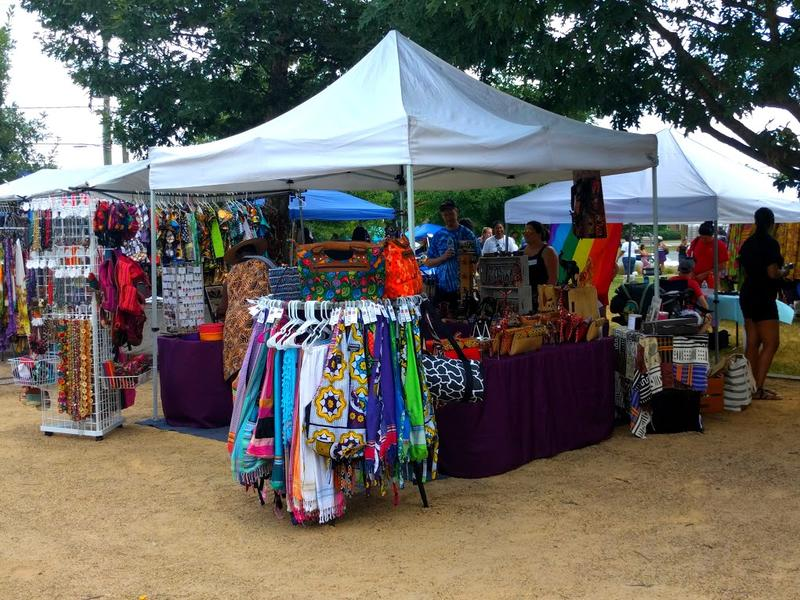 A stall featuring African-style clothing and accessories.