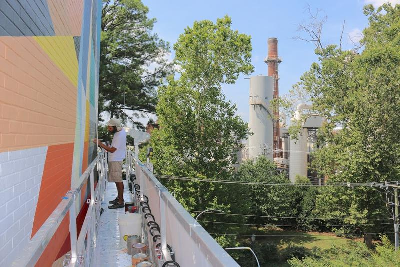 Josh Smith, another Philadelphia artist, is helping David Guinn execute the mural.