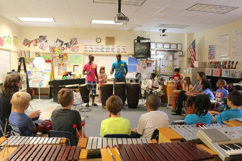 Rwandan artist (and former street child) Pacifique Niyonsenga and his brother Patrick teach traditional drumming to the 3rd graders in Piper Gary's music class at Woodbrook Elementary.