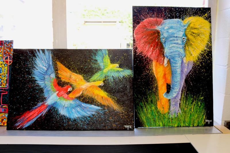 These are two of Figy's eye-popping paintings. Part of the proceeds from the sale of these paintings will be used to support the NIYO Cultural Center in Kigali, Rwanda.