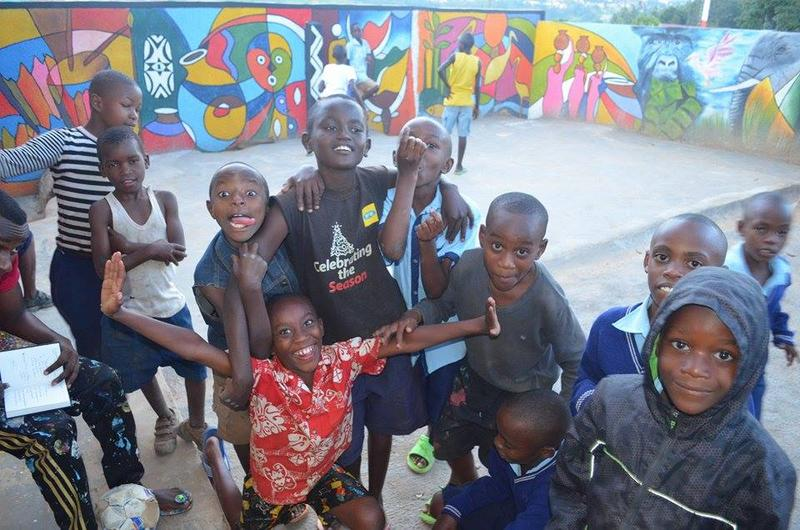A few of the children who attend the NIYO Cultural Center in Kigali goof around for the camera. At the Center, students learn a variety of arts, including painting, dancing and drumming.