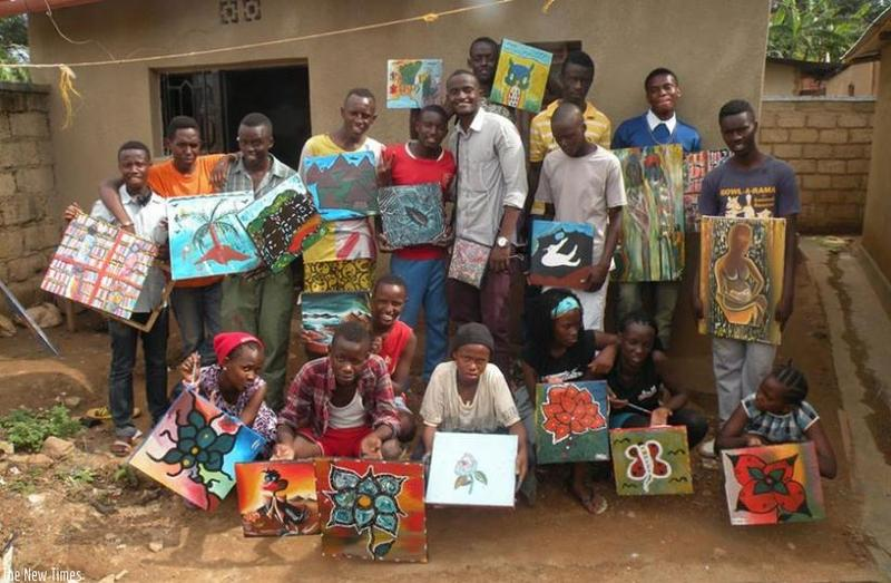 Pacifique Niyonsenga poses with student artists at the NIYO Cultural Center. For the deeply impoverished children attending the center, art is not only a way to make a living, but is also a form of therapy.