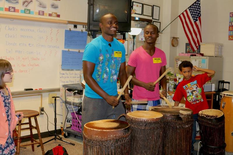 Pacifique (in blue) and Patrick (in pink) use these same drums to teach dancing & drumming lessons to the street children who now attend the NIYO Cultural Center which Pacifique founded in Kigali, Rwanda.