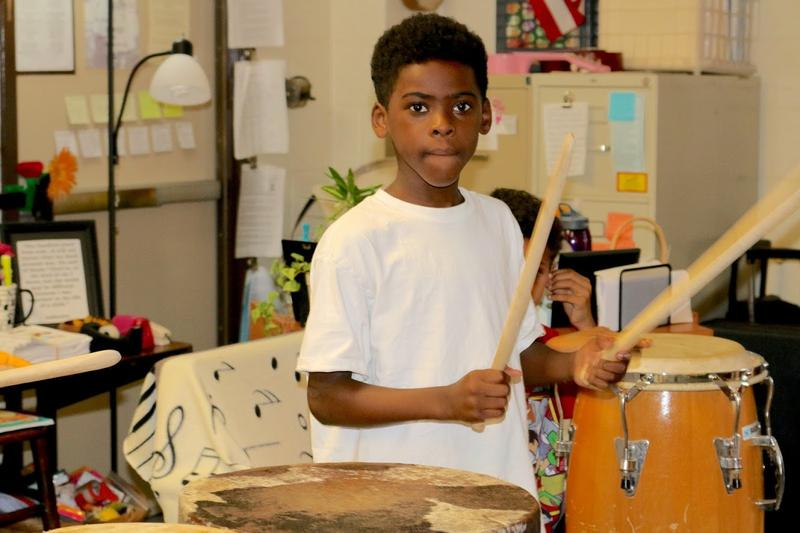 J Kai stood at the head of the class to help demonstrate good drumming technique to his fellow third graders.