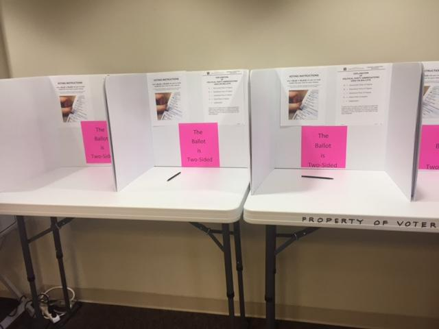 Absentee in-person voting booths at Charlottesville Registrar's Office.