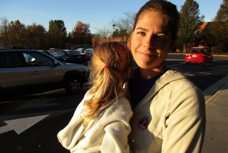 Suzanne Smith and her three-year-old daughter Cora outside Keister Elementary School after voting this morning.