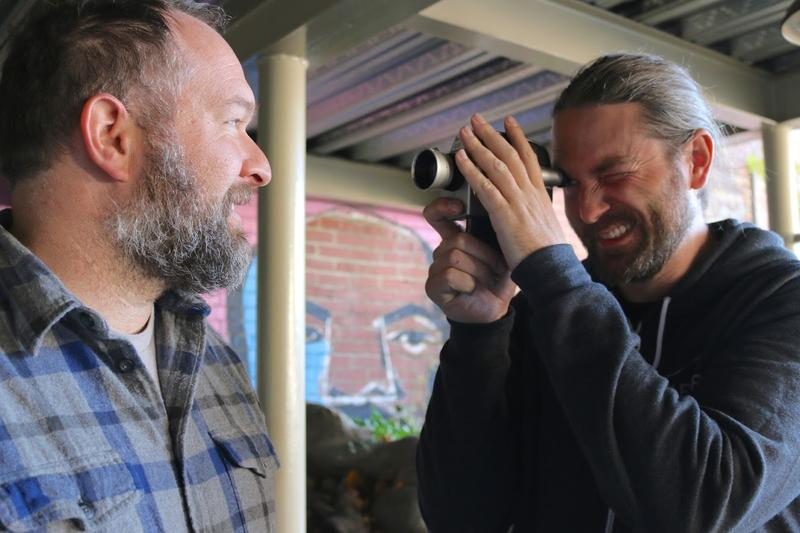 Ask Paul Somers to pretend to film Tim Estep with a Super 8 camera, and they'll both oblige. But they do want to clarify that, at this proximity, the camera would be WAY out of focus.