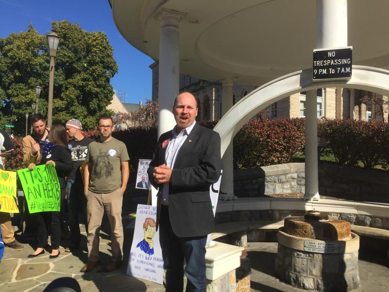 Democratic candidate Kai Degner speaks to protesters gathered at the fountain in Harrisonburg's Court Square during Saturday's NORML rally.