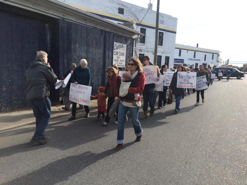 Protestors walk from Liberty Park to George's Poultry Plant in downtown Harrisonburg.