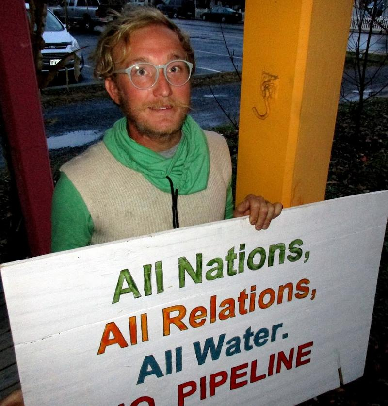 Cornelius Frantz with a sign that accompanied Renew Rocktown's teepee to raise local awareness about the Standing Rock protest.