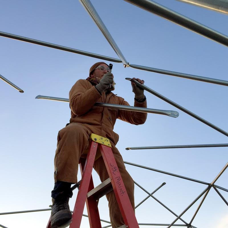 Frantz works on a geodesic dome for winter housing.