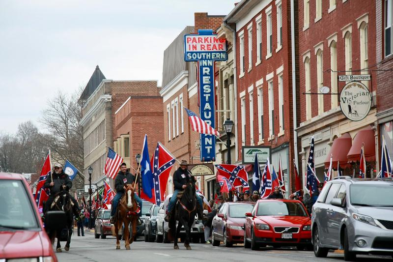 About 150 Virginia Flaggers marched on Saturday to celebrate Lee-Jackson Day. Without a parade permit, they were forced to march on the sidewalk, except for the horses.