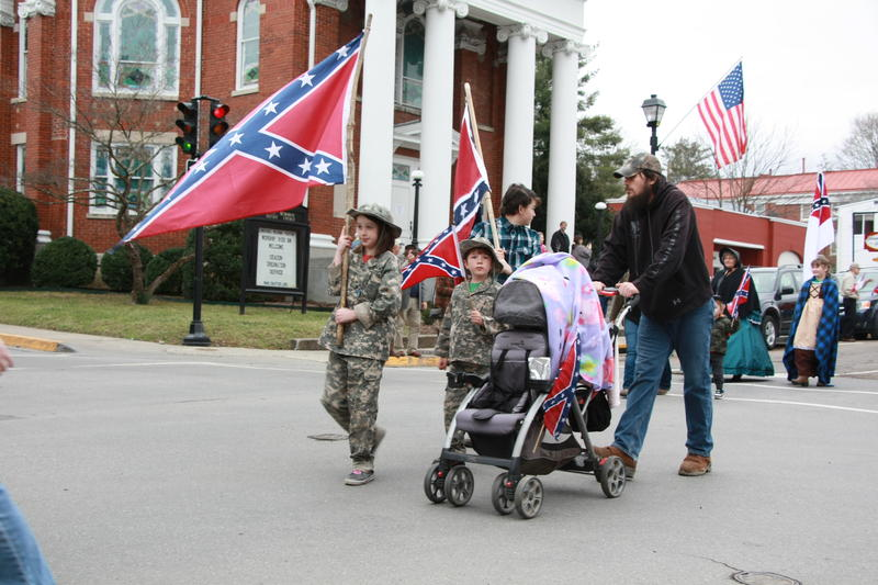 Cole Morrison and his family march with the Sons of Confederate Veterans on Sunday in Lexington.