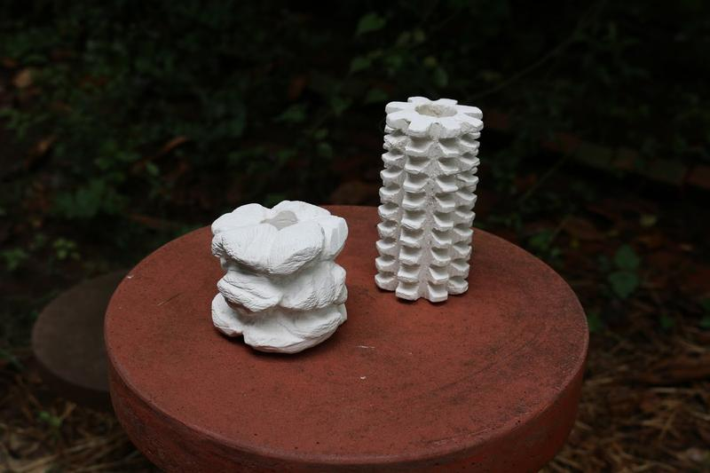 """The Concrete Oyster Reef Restoration Disc or """"CORRD"""" (shown here in 2 prototype forms) is designed, in part, for oyster farmers. The discs can be hung from pipes or ropes under piers, and should be harder to steal than free-floating oyster baskets."""