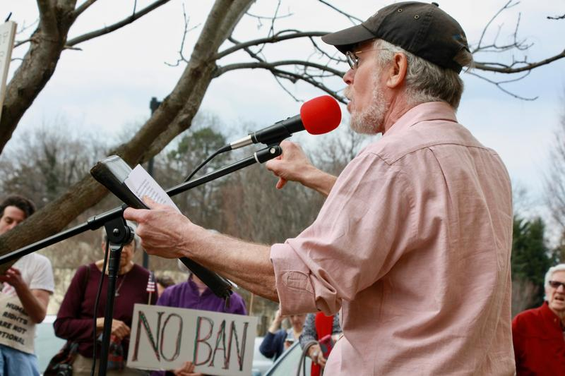 Area activist Larry Stopper rallied the crowd with demands to keep the Affordable Care Act in place.