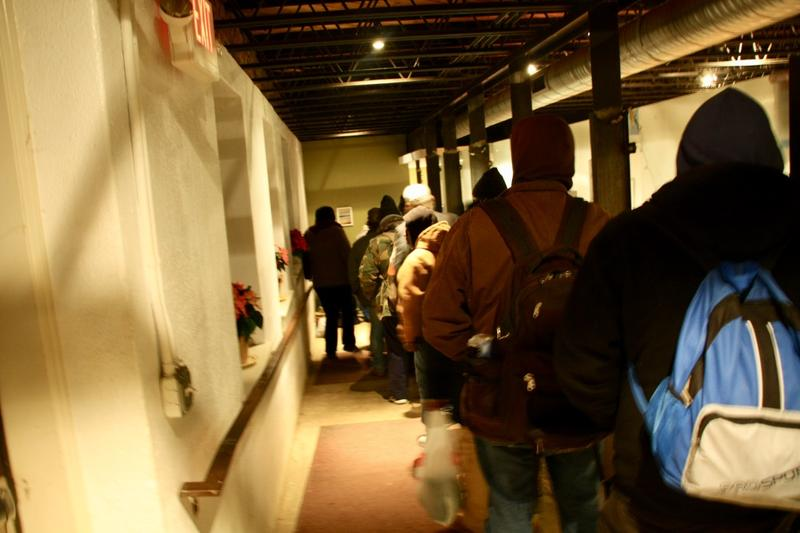 Homeless men line up in the basement of The Haven to be admitted into PACEM for the night. On average about 40-45 men and 10-15 women need shelter each night during the winter.