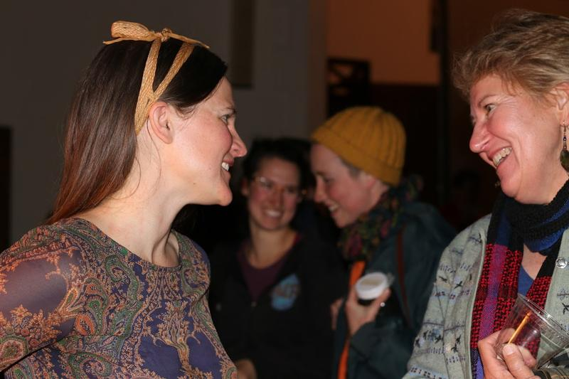 Devon Sproule chats with an attendee after the event.