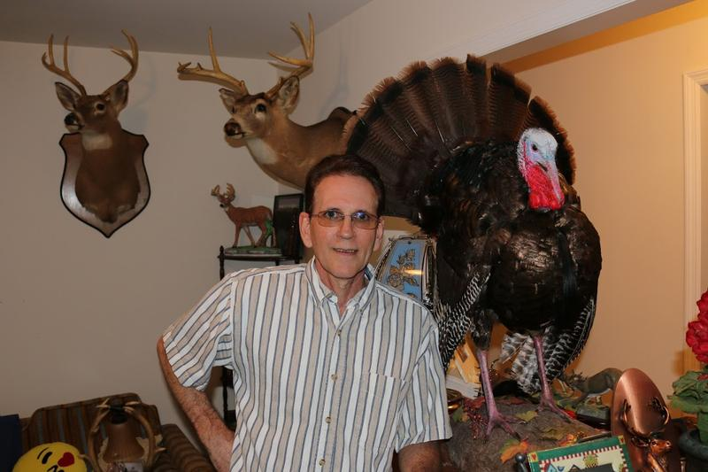 On his good days — when the aftereffects of cancer radiation and surgery don't keep him home — 54-year old Keith Hart loves to hunt and fish in the woods near his house in eastern Virginia. Here he poses near a wild turkey and deer, in his guest room.