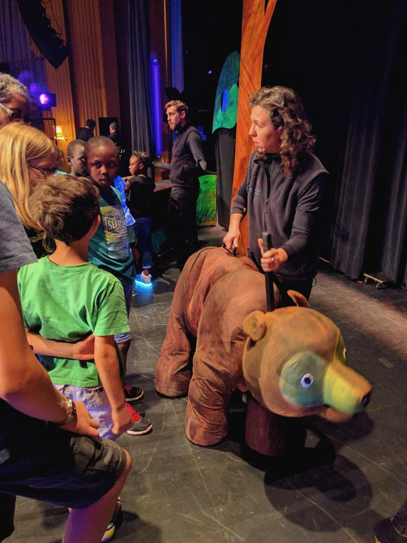 Michelle Urbano, with the Mermaid Theatre of Nova Scotia, takes the bear puppet for a walk.