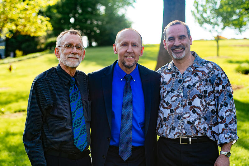 Gregory Winship, the first graduate of Eastern Mennonite University's Master of Arts in Restorative Justice program, with Howard Zehr (left) and faculty advisor Carl Stauffer.