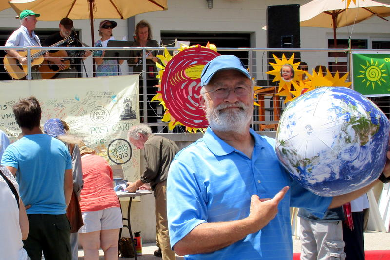 "While Doug Hendren, Nancy Beall, and friends sang, rally attendee Yogi Gillette said, ""I think it's kind of silly to abandon the Paris Accord. It was a worldly thing to do."""