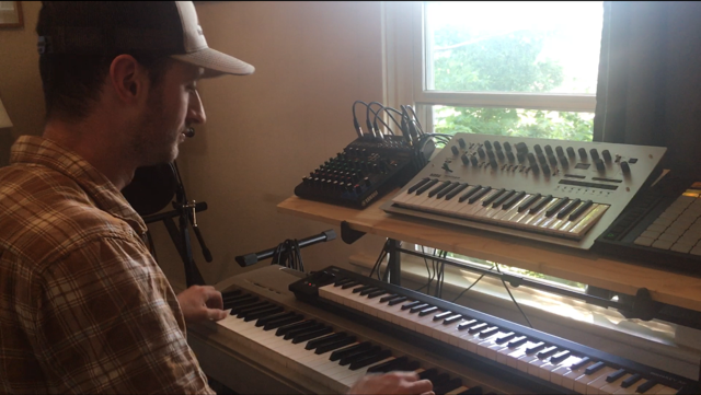 Cook plays keyboard at his in-home mixing station.