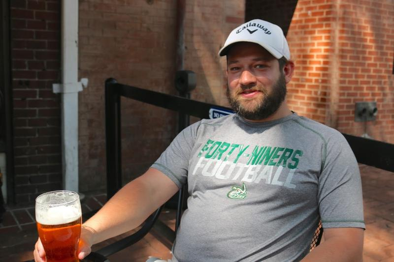 "Jeremiah Welch enjoyed a beer with friends at Miller's on the downtown mall, which offered a day of live music performances to help counter the Klan rally. ""I don't know if Thomas Jefferson would like all these shenanigans,"" Welch said."