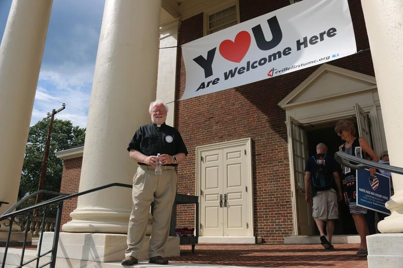 Just a few blocks from the KKK rally site, the First United Methodist Church offered a safe space for protestors to gather on Saturday. Pastor Al Horton and his colleagues provided prayer, music, comfort and bottled water to visitors.