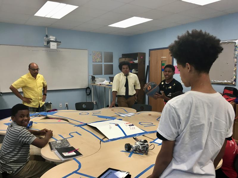 Pastor Rickey White and longtime 100 Black Men of Central Virginia member Alex Beverly co-teach a course on algebra and robotics.