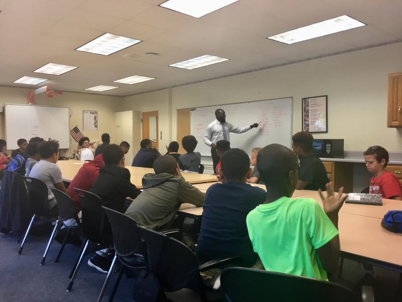 Charlottesville Vice-Mayor Wes Bellamy teaches the two-week academy, leading the kids through lessons on stereotypes, financial budgeting, setting career goals, and much more.