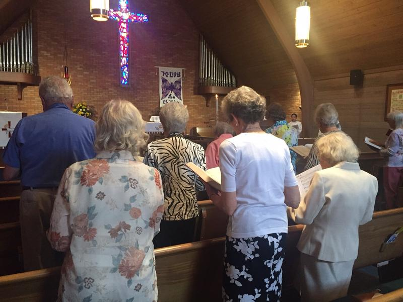 The congregation rises in song at St. Mark, where Parvin is now the second female pastor.