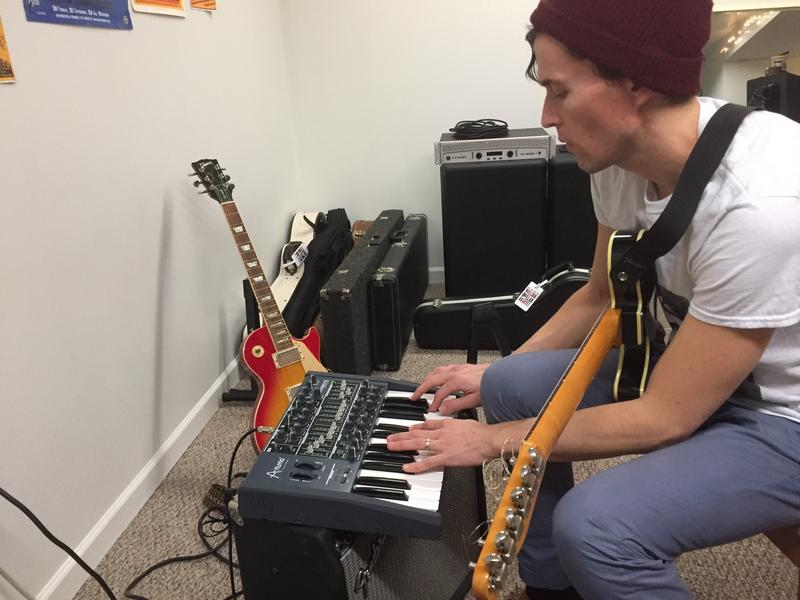 "Harrisonburg musician Matthew ""Snake"" Osburn plays on an Arturia Minibrute analog synthesizer in his home studio."