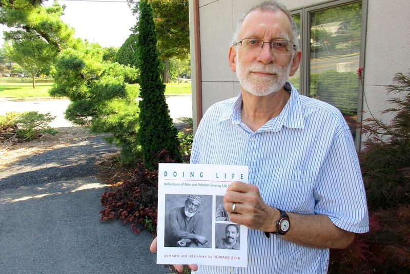 "Howard Zehr with his 1996 book Doing Life: Reflections of Men and Women Serving Life Sentences. Zehr has been revisiting about two dozen of those men and women, preparing a follow-up, which he's calling ""Coping with Life."""