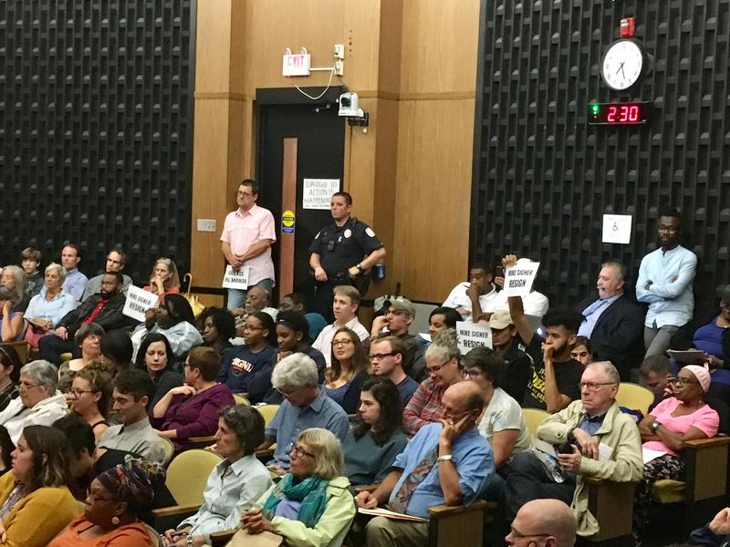 Charlottesville residents called for the resignations of city councilors Mike Signer and Kathy Galvin on Tuesday, saying that the city has not done enough to support its poorest and most vulnerable residents.