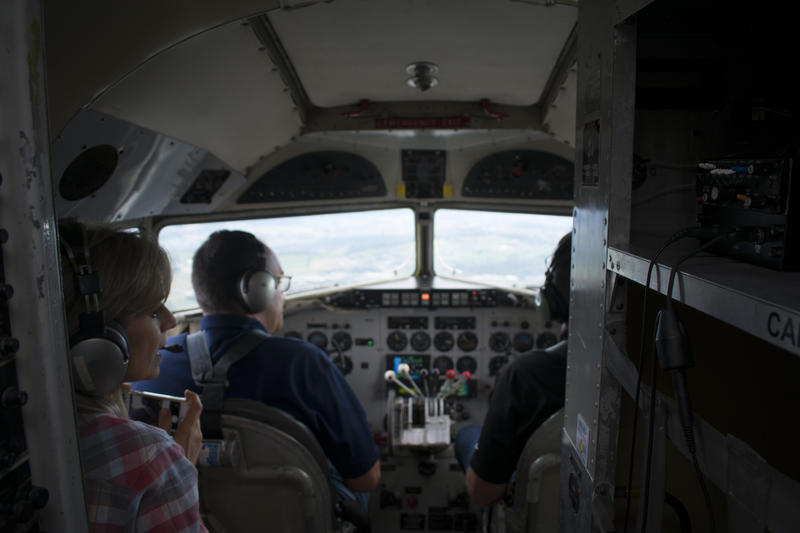 Micheal Slotzfus and Rod Moyer fly the DC3 while Deborah Hedrick watches and listens.
