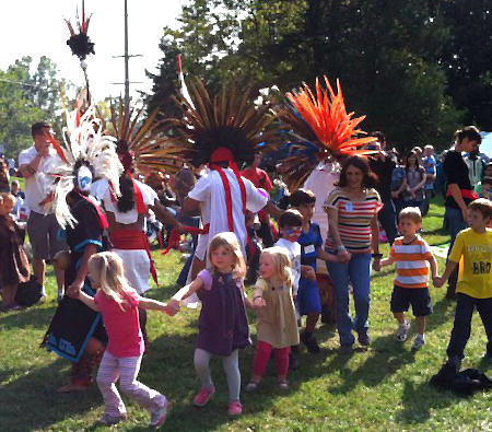 The Muniz family leads the International Festival with a traditional Aztec dance from their native Mexico.