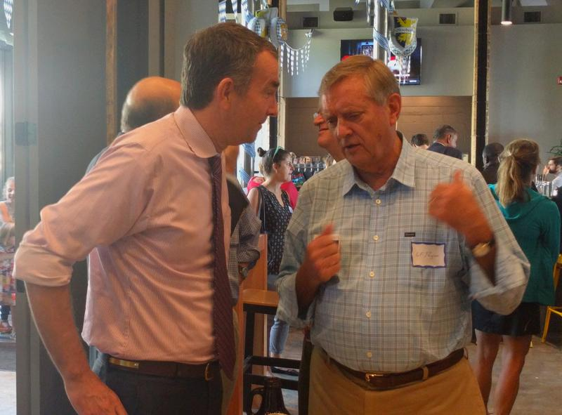 Ralph Northam talks with former Democratic representative for Virginia's 5th congressional district Lewis F. Payne, Jr.